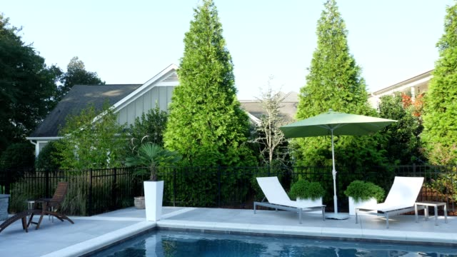 swimming pool - patio stock videos & royalty-free footage