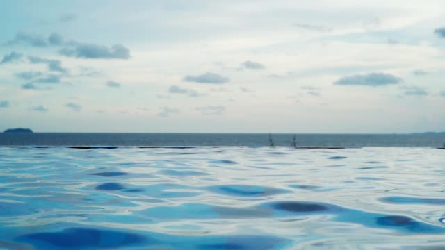 swimming pool water summer resort slow motion. - summer resort stock videos & royalty-free footage