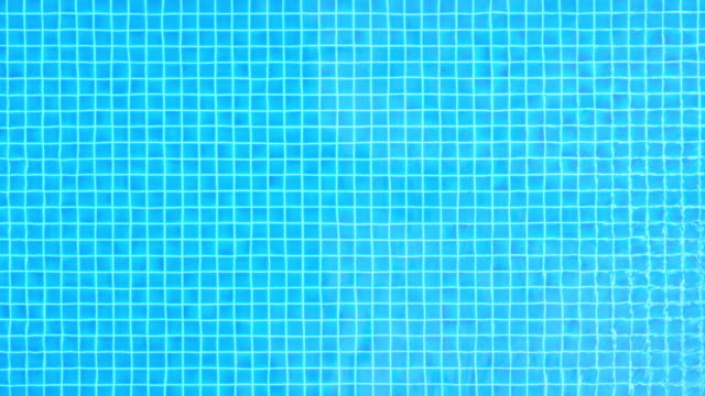 swimming pool water surface(uhd) - standing water stock videos & royalty-free footage