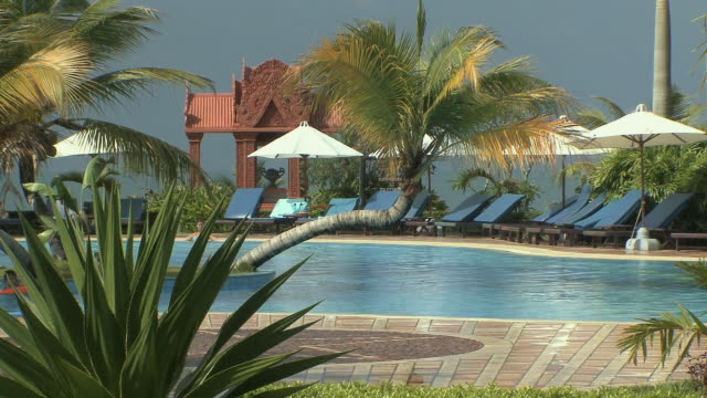 ws swimming pool with palm trees, sihanouksville, cambodia - cambodia stock videos & royalty-free footage
