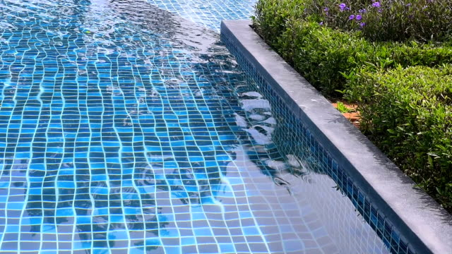 swimming pool with ripple water - tile stock videos & royalty-free footage