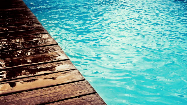 swimming pool with wooden deck - ponte di una nave video stock e b–roll