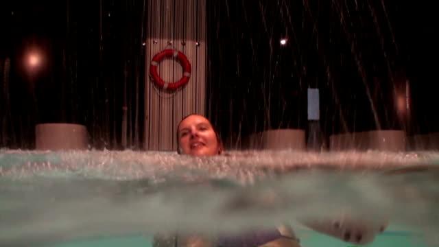 Swimming underwater and enjoying water jets