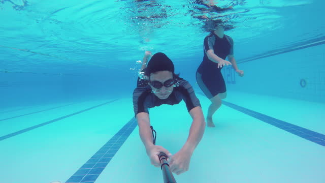 Swimming underwater in a swimming pool