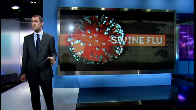 stockvideo's en b-roll-footage met swine flu continues to spread worldwide; england: london: gir: int reporter to camera with graphics on screen behind - varkensgriep