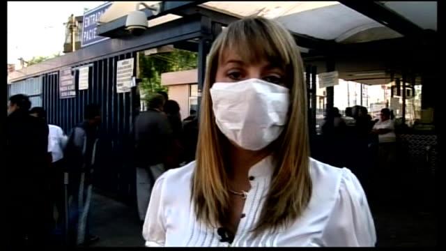 swine flu continues to spread worldwide reporter to camera - swine influenza virus stock videos and b-roll footage