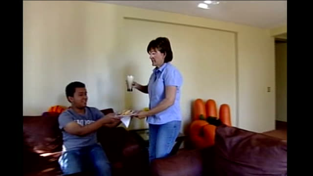 stockvideo's en b-roll-footage met emergency measures taken to tackle disease; ext reporter speaking to maria magania int maria and xavier magania sitting on sofa dr magania along as... - varkensgriep