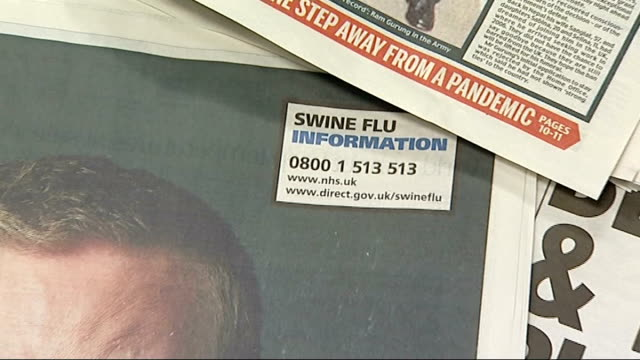 stockvideo's en b-roll-footage met swine flu may not become the fatal pandemic feared; england: london: int full page swine flu information advert in newspaper sir liam donaldson... - varkensgriep