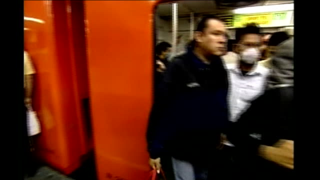 stockvideo's en b-roll-footage met mexican testing system struggling to differentiate swine flu from ordinary flu; mexico: mexico city: int underground train doors opening as... - varkensgriep