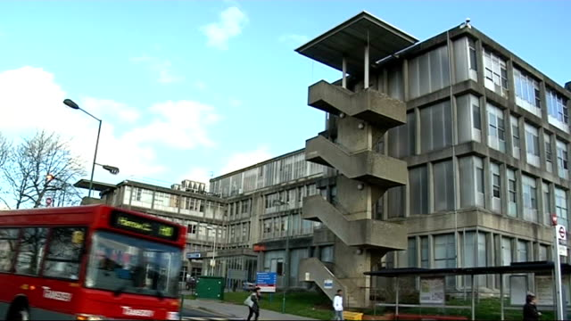 stockvideo's en b-roll-footage met swine flu outbreak; date unknown: england: north west london: northwick park hospital: ext slow motion shot of northwick park hospital as bus passes... - varkensgriep