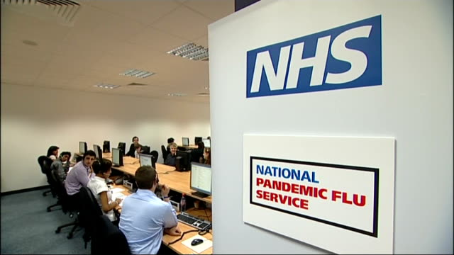stockvideo's en b-roll-footage met national pandemic flu service call centre; england: london: southwark: nhs swine flu call centre: int general views of staff in nhs national pandemic... - varkensgriep