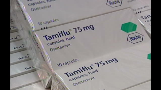 results of independent review published 2009 boxes of tamiflu drugs opened close up of packs of tamiflu antiviral drugs stack of boxes of tamiflu... - swine influenza virus stock videos and b-roll footage
