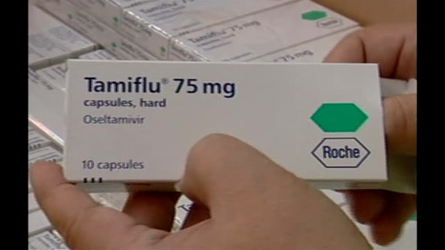stockvideo's en b-roll-footage met two cases confirmed in scotland; lib secret location: department of health warehouse: boxes of tamiflu anti-viral medication stacked on pallets in... - varkensgriep