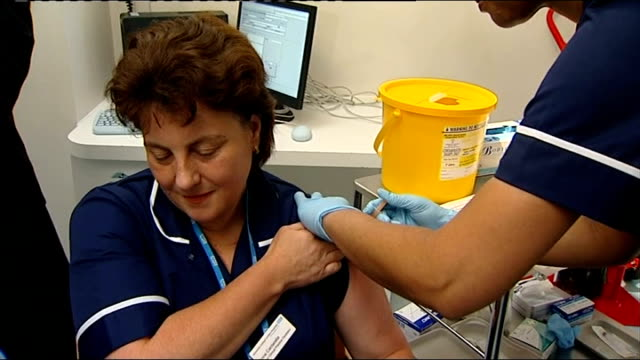 swine flu vaccine takeup concerns healthcare worker administering flu vaccination to other nurse - swine influenza virus stock videos and b-roll footage