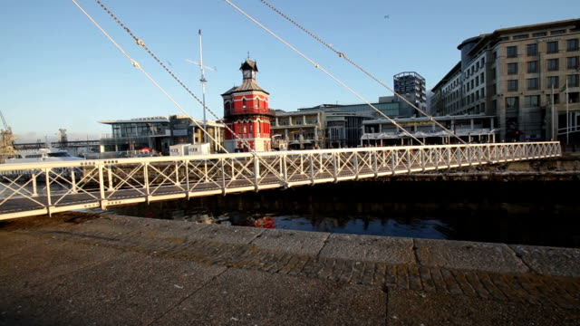 swing bridge at the victoria and alfred waterfront, cape town, south africa - swing bridge stock videos & royalty-free footage