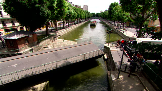 a swing bridge closes over a parisian canal. - swing bridge stock videos & royalty-free footage