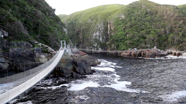 swing bridge over the storms river mouth - swing bridge stock videos & royalty-free footage
