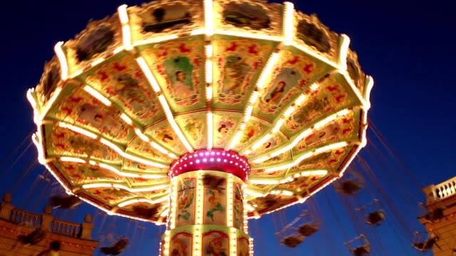 swing chairs in amusement park - roundabout stock videos & royalty-free footage