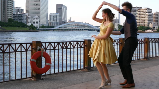 vidéos et rushes de swing dancers at sunset - rock