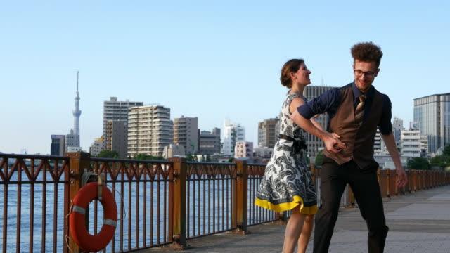 swing dancers at sunset - ballroom dancing stock videos & royalty-free footage