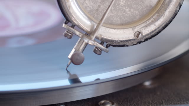 swing is back. close up of a retro gramophone playing an old record. - disk stock videos & royalty-free footage