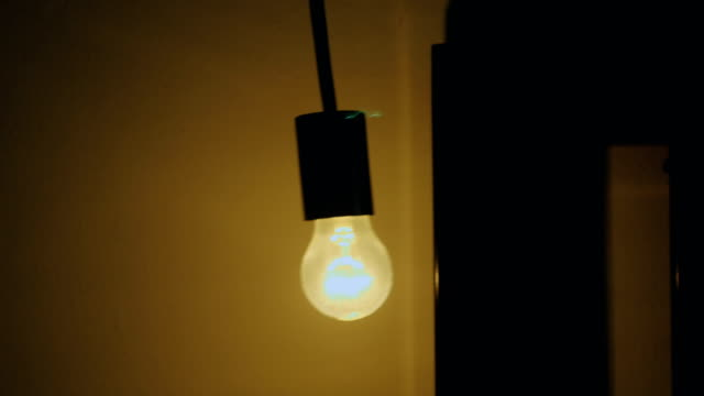 swing : light bulb on a black background - old lightbulb stock videos and b-roll footage