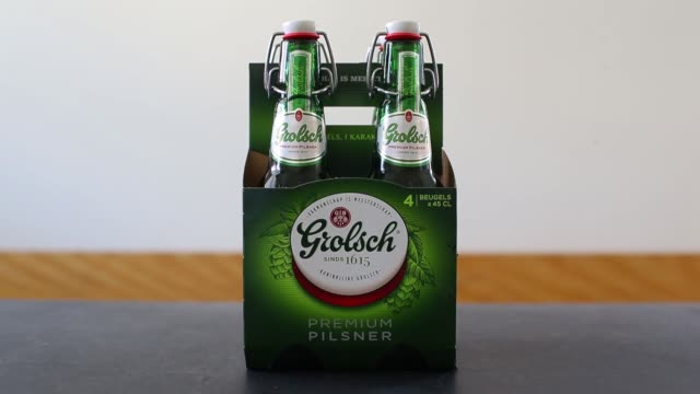 swing top lids sit on grolsch beer bottles produced by sabmiller plc in utrecht netherlands on sunday may 1 2016 - utrecht stock videos & royalty-free footage