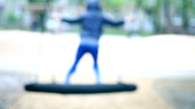 swinging boy - tyre swing stock videos & royalty-free footage