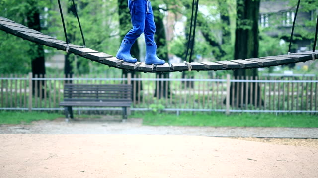 swinging boy - climbing frame stock videos & royalty-free footage
