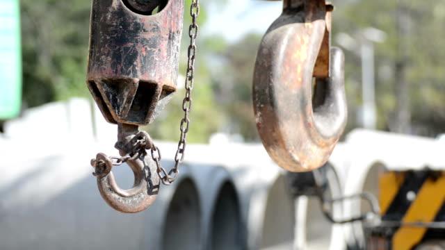 swinging crane hook - hook stock videos and b-roll footage