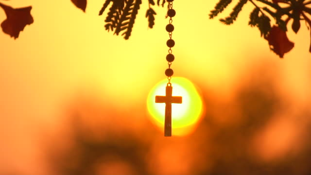 swinging cross - prayer beads stock videos & royalty-free footage