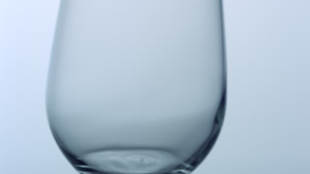 Swinging empty glass, slow motion-close up