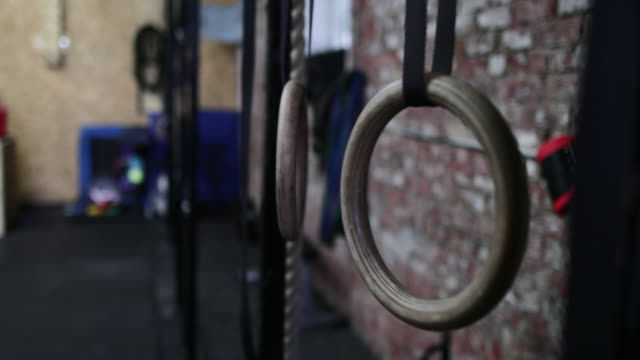 swinging gymnastic rings - gymnastic rings stock videos & royalty-free footage