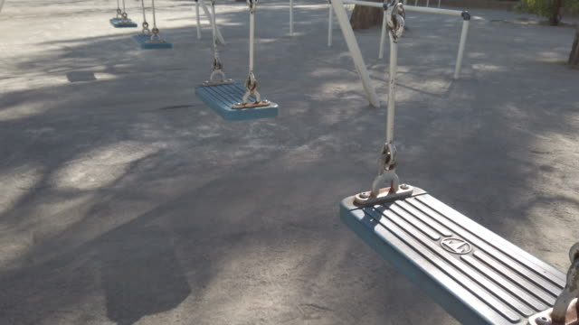 swinging swings - playground stock videos & royalty-free footage