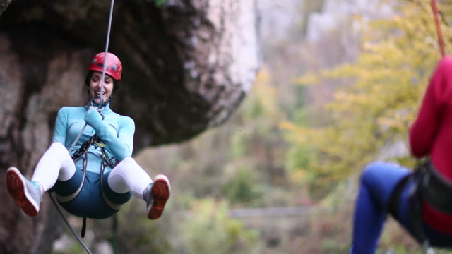swinging time - abseiling stock videos & royalty-free footage