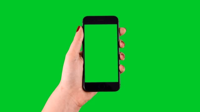 vídeos de stock e filmes b-roll de swipe up and down smart phone displaying chroma key on green screen - visão frontal
