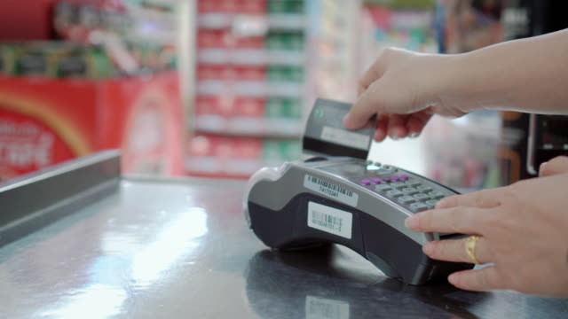 swiping a credit card at supermarket checkout,close-up - checkout stock videos and b-roll footage