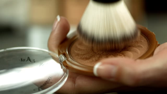 hd: swirling brush into a face powder - blusher make up stock videos and b-roll footage
