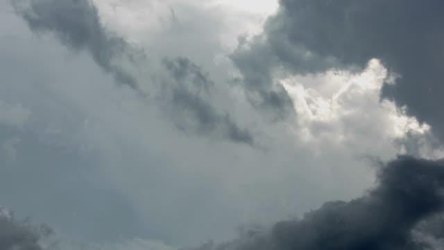 Swirling clouds in darkening sky