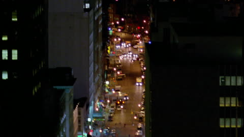 swish pan from manhattan skyline with empire state building to street with traffic and back at night / nyc - swish pan stock videos & royalty-free footage