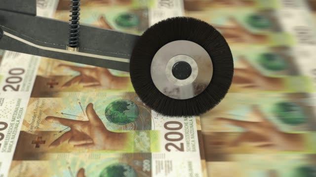 vidéos et rushes de 200 billets francs suisses imprimés - switzerland