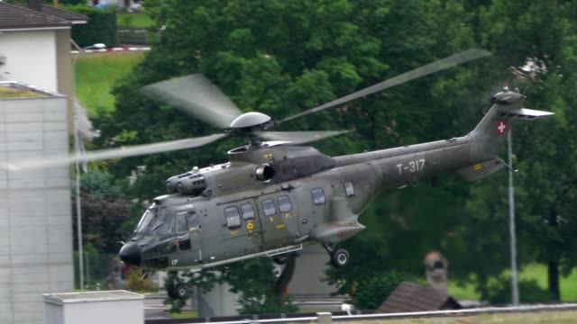 swiss army helicopter flying in the air - military helicopter stock videos and b-roll footage