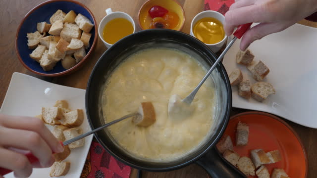 swiss cheese fondue - tradition stock-videos und b-roll-filmmaterial