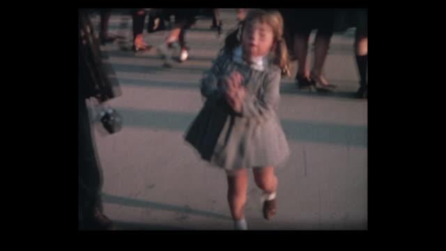 stockvideo's en b-roll-footage met 1964 swiss expo girl jumps for joy - tentoonstelling