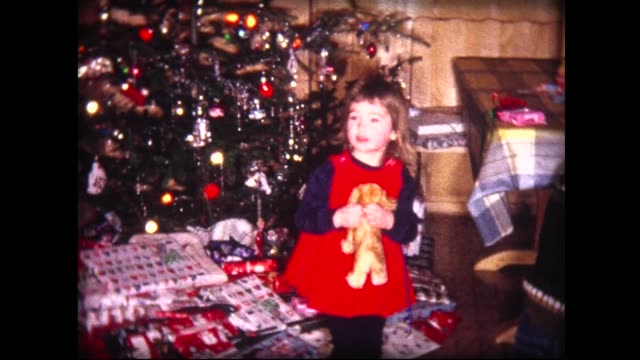 stockvideo's en b-roll-footage met 1963 swiss family christmas morning with tree - 1963