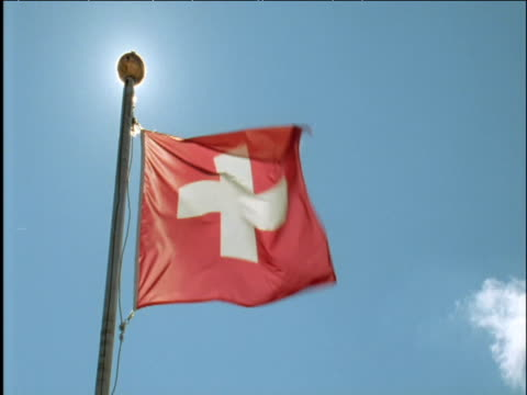 Swiss flag billows in breeze Switzerland
