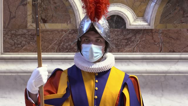 swiss guard wears a protective face mask as pope francis presides over mass on easter sunday morning in st. peter's basilica at the altar of the... - live broadcast stock videos & royalty-free footage