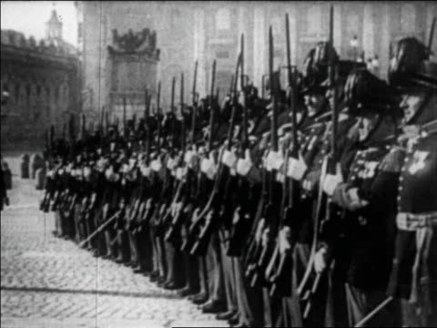swiss guards in uniform with guns standing at attention / vatican city / newsreel - honour guard stock videos & royalty-free footage