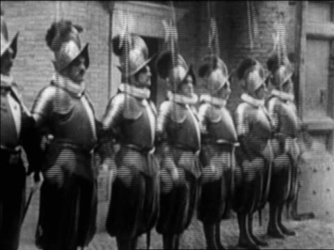 swiss guards in uniform with spears standing at attention outdoors / vatican city - honour guard stock videos & royalty-free footage