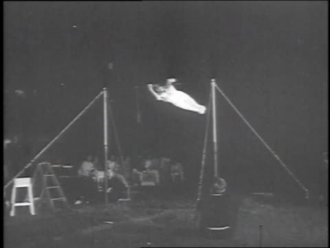 swiss gymnast performing routine on the high bars / berlin, germany - 1951 stock-videos und b-roll-filmmaterial